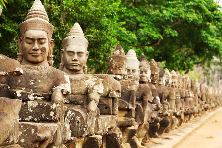 temple: Faces at the entrance of Bayon Temple, Angkor Wat, Cambodia Stock Photo