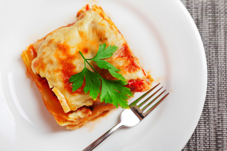 Typical italian lasagna served in a plate, one portion photo