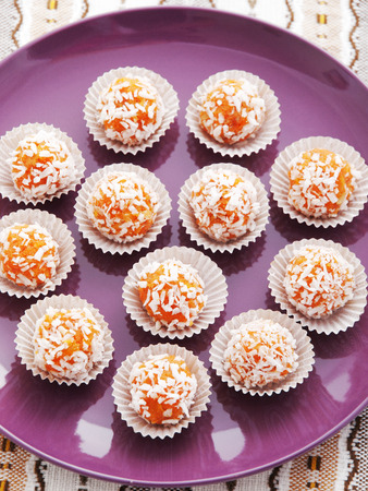 Homemade carrot candies with sugar and nuts photo