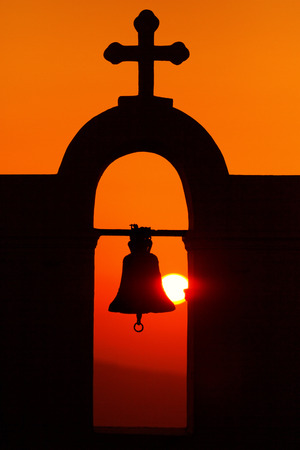 fira: Famous church in Fira, Santorini at sunset Stock Photo