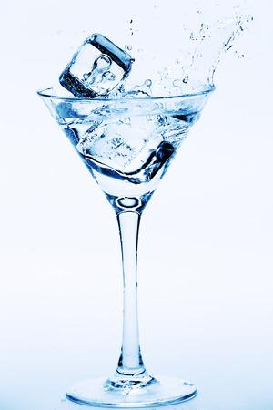 martini splash: Martini splash with ice cubes