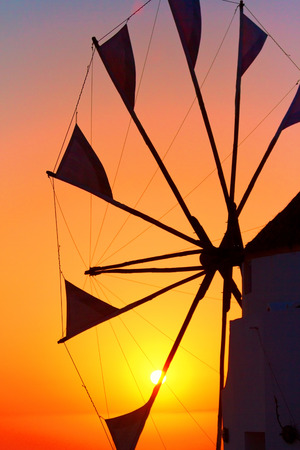 oia: Windmill in Oia at sunset, Santorini, Greece