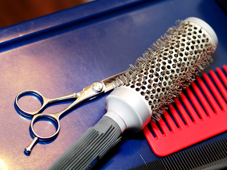 haircutting: Hair Studio Stuff - hair brushes, haircutting scissors, hair straightener Stock Photo