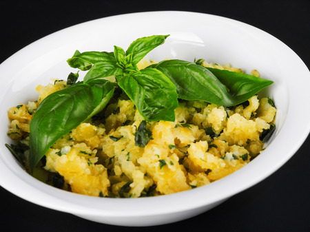 potato salad: Potato salad with herbs garnished with fresh basil Stock Photo
