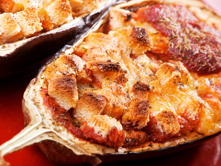 greek cuisine: Stuffed eggplants (greek cuisine), one portion