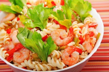 shrimp: Italian salad made of fusilli, shrimp, celery, decorated with celery leaves Stock Photo