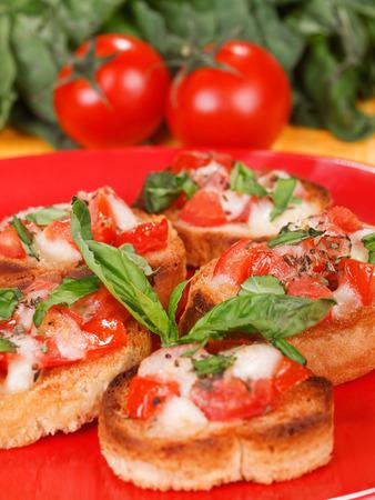 Italian bruschetta with tomato, mozzarella and basil photo