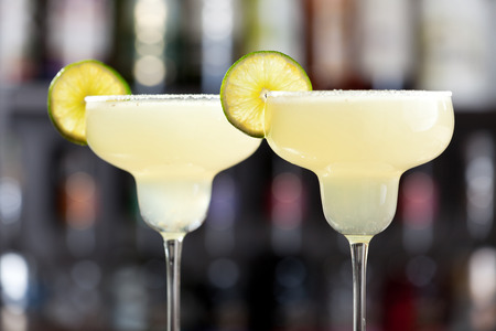 margarita glass: The margarita is a cocktail consisting of tequila mixed with orange-flavored liqueur and lime or lemon juice, often served with salt on the glass rim. Stock Photo