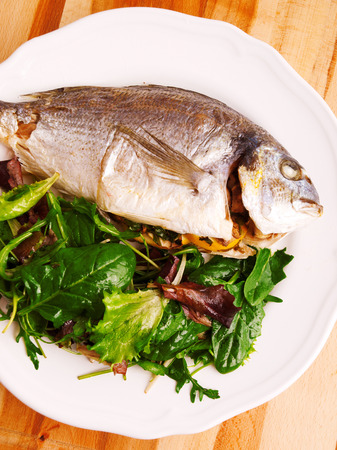 gilthead bream: Fresh grilled Gilt-head bream with green salad