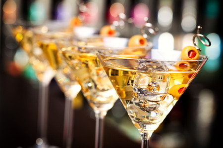 Several glasses of famous cocktail Martini, shot at a bar with shallow depth of field  Banque d'images