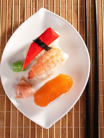 Three types of nigiri sushi - with salmon, shrimp and surimi