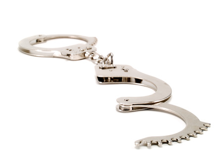 handcuffs: Handcuffs on white
