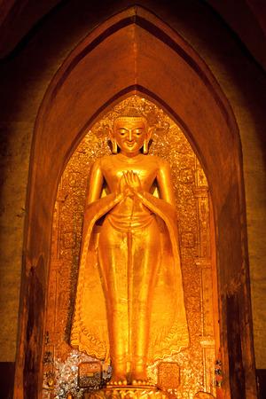 Golden statue of Buddha in Ananda Temple in Bagan, Myanmar
