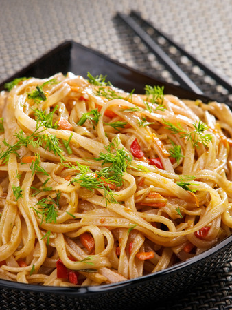 hoisin sauce: Asian noodles with hoisin sauce and peppers Stock Photo