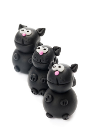 polymer: Black cats made of polymer clay Stock Photo