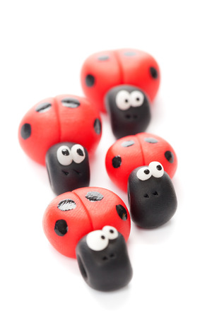 four objects: Ladybirds made of polymer clay