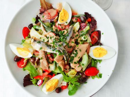 seafood salad: Nicoise Salad served in a restaurant in Cannes, France Stock Photo