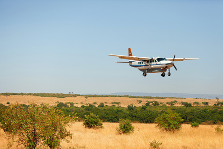 Small plain in Masai Mara, Kenya, just about to land