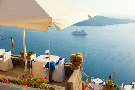 Local restaurant in Fira with a view to the sea Standard-Bild