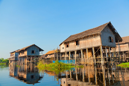 Ttraditional floating village houses in Inle Lake photo