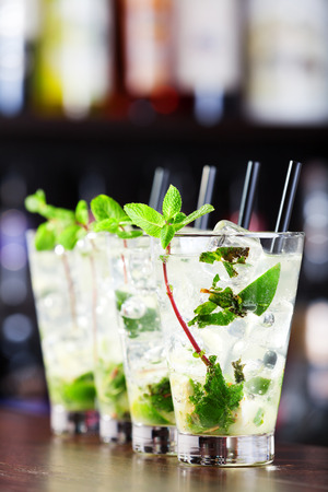 Ingredients:  3 fresh mint sprigs  2 tsp sugar  3 tbsp fresh lime juice  1 12 oz light rum  club soda Stock Photo