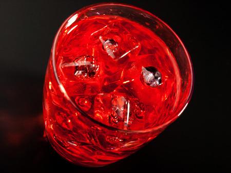 grenadine: Ingredients:  2 oz rum 1 oz triple sec 1 oz vermouth 1 splash grenadine Stock Photo