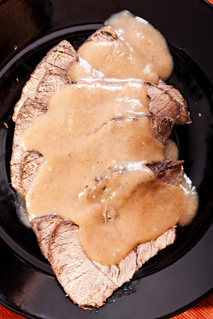 stewed: Horse meat, stewed with mushroom sauce Stock Photo