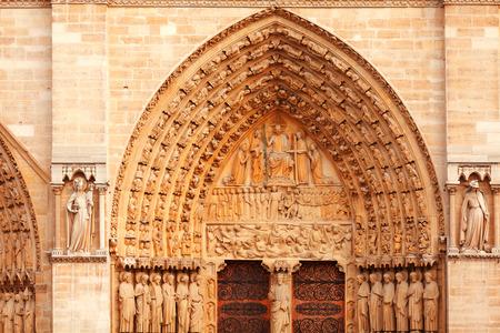 ile de la cite: Detail of the facade of Notre Dame in Ile de la Cite, Paris