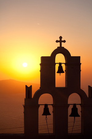 fira: Famous church in Fira, Santorini at sunset Stock Photo