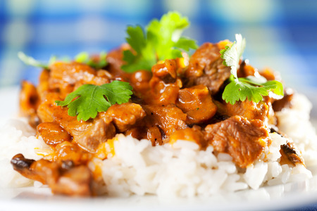 cilantro: Pork curry with rice and cilantro