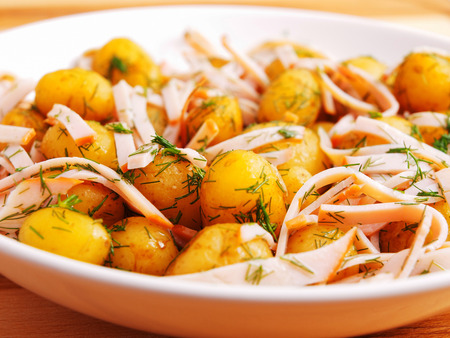 Fried baby potatoes with bacon photo