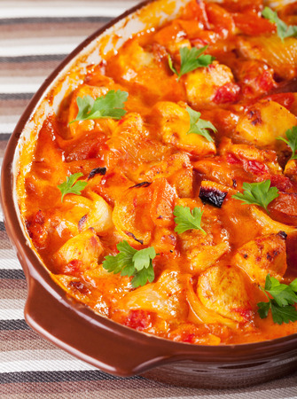 potatos: Casserole with chicken, potatos and tomatos in a baking dish, ready-to-eat Stock Photo