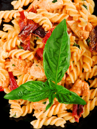 fullframe: Fusilli with salmon and dried pepper, close up Stock Photo
