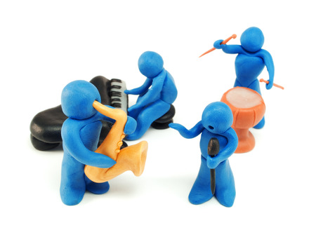 Many plasticine people performing a son photo