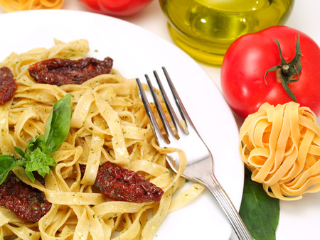 Tagliatelle with salmon, basil and dried tomatoes photo