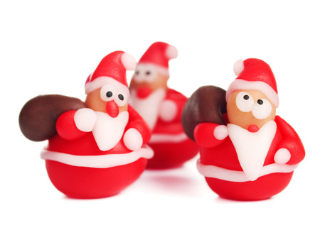 Polymer clay santas, handmade christmas decoration, isolated on white, made from polymer clay photo