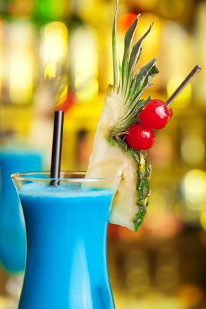 blue hawaiian drink: Blue Hawaiian cocktail on a bar Stock Photo
