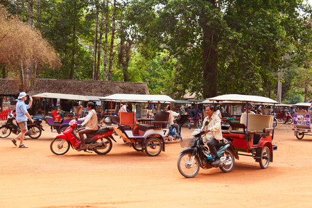 Angkor Wat, Cambodia - March 19, 2011 : Cambodian tuk-tuk drivers waiting for tourists for a ride across the temples of ancient Angkor