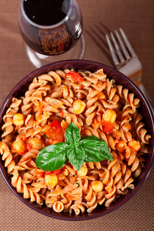 fullframe: Fusilli with chick-peas, close up Stock Photo