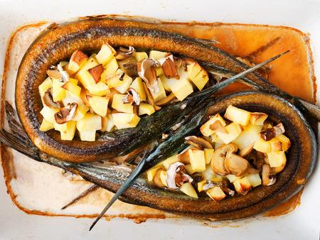 potatos: Garfish with potatos Stock Photo