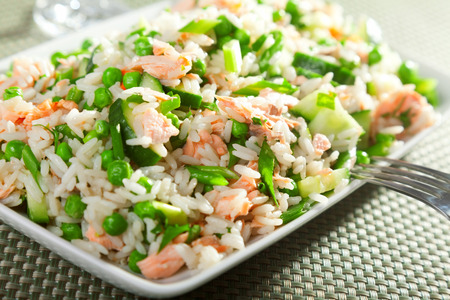 salmon fish: Rice salad with salmon, cucumbers, peas and spring onion, one portion