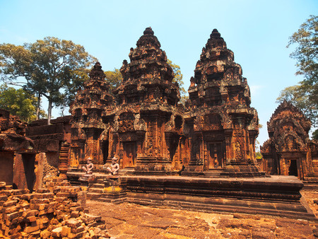 intricacy: Banteay Srei - 10th century Cambodian temple dedicated to the Hindu god Shiva, located in the area of Angkor in Cambodia. It is built largely of red sandstone. Banteay Srei is known for the intricacy of its carvings and saturated colors.