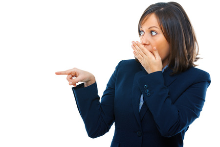 secretly: Businesswoman pointing and secretly laughing isolated on white background Stock Photo