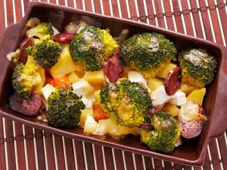 brocolli: Brocolli and potato casserole in a baking dish on the table Stock Photo
