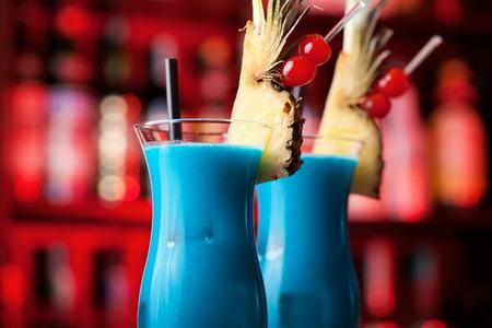 blue hawaiian drink: Ingredients:   1 oz light rum  2 oz pineapple juice  1 oz Blue Curacao liqueur  1 oz cream of coconut Stock Photo
