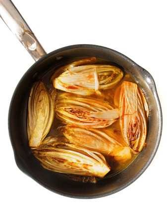 side dish: Side dish with fried chicory in sweet orange sauce, perfect for fish and white meat Stock Photo