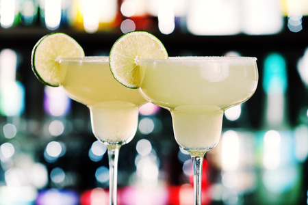 The margarita is a cocktail consisting of tequila mixed with orange-flavoured liqueur and lime or lemon juice, often served with salt on the glass rim.The drink is served shaken with ice, on the rocks, blended with ice (frozen margarita) or without ice (s