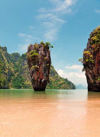 Khao Phing Kan is a pair of islands on the west coast of Thailand, in the Phang Nga Bay, Andaman Sea, near Phuket. About 40 metres from its shores lies a 20 meters tall islet Ko Tapu or Khao Tapu. The island is a part of the Ao Phang Nga National Park. Si photo