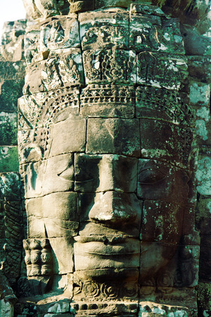 fullframe: Close up of a large stone carved face of Bayon Temple in Angkor Thom, Angkor district, Siem Reap, Cambodia