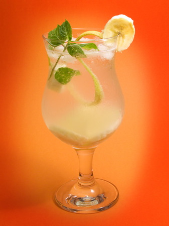 vignetted: This amazing cocktail is made of: 1 oz vodka 1 oz apricot brandy 1 oz bananna liqueur Juice of half lime Soda water to taste Half bananna cut in slices  Garnish with mint